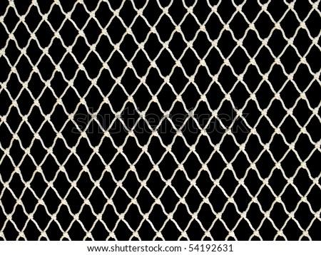 White fishing net on black background. - stock photo