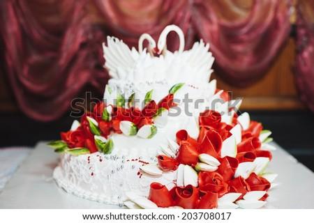 white floral wedding cake on restaurant interior background - stock photo