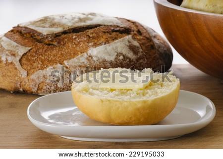 White flour dinner bun with butter - stock photo