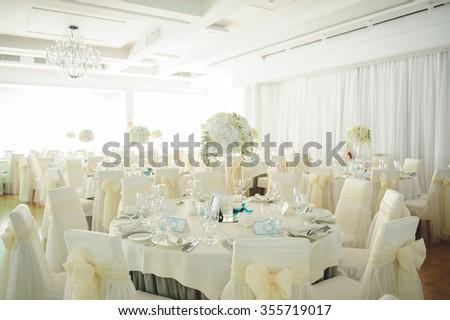 white flower composition on fest table at restaurant - stock photo