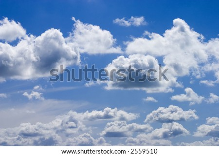 White fluffy clouds and blue sky - stock photo