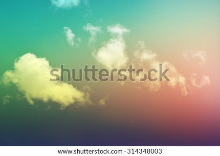 white fluffy clouds in  sky (green violet retro style ) - stock photo