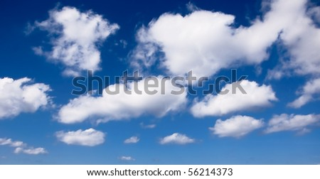white fluffy soft clouds on a blue sky - stock photo