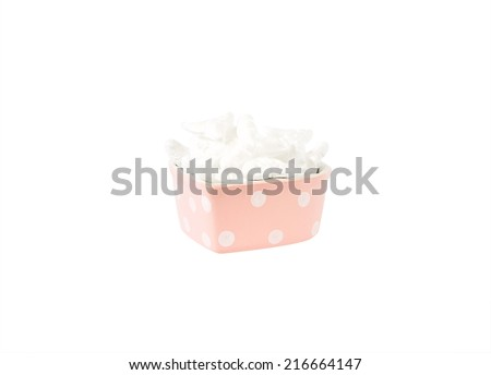 white foam filler in pink heart shaped plate isolated on white background - stock photo