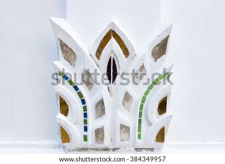 White foliage stucco with glass in the traditional Thai style . - stock photo