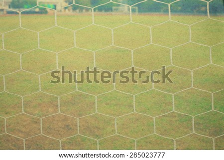 white football net, green grass paper picture - stock photo
