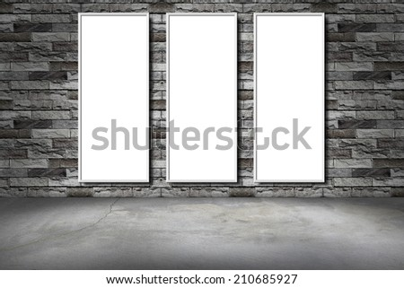white frame on a brick wall and the concrete floor - stock photo