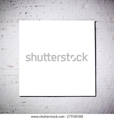 White frame on  white brick wall in museum - stock photo