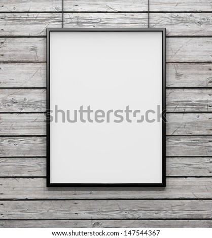 white frame on wood wall - stock photo