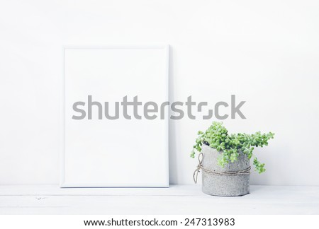 white frame with place for text  with succulent in diy concrete pot. Scandinavian style room interior - stock photo
