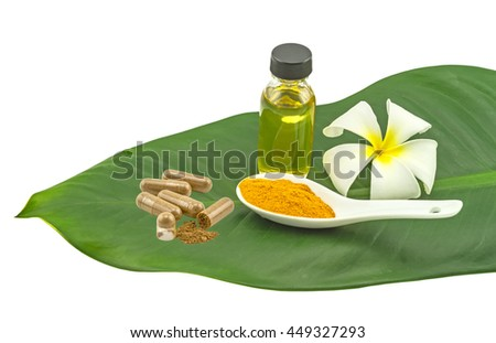 White frangipani flowers (Plumeria spp,Apocynaceae, Pagoda tree , Temple tree) pill , turmeric powder in white spoon and massage oil  in green leaf isolate on white background.Saved with clipping path - stock photo