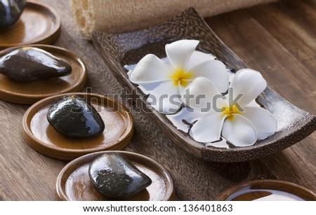 White frangipani with zen stone - stock photo