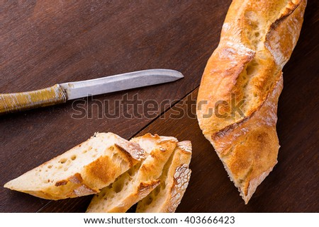 White french baguette on a wooden board, bakers, food background is - stock photo