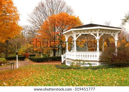 White Gazebo and autumn trees in the park               - stock photo