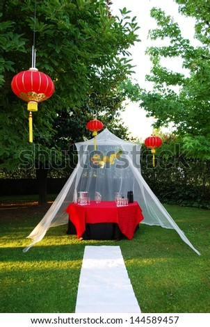 White gazebo and red chinese lantern in the park - stock photo