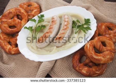 White german sausage with mashed potato and pretzel - stock photo