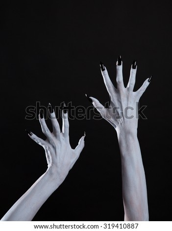 White ghost or witch hands with sharp black nails, body art, Halloween theme  - stock photo