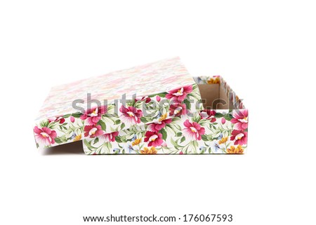 white Gift box with red blue and orange flowers. Isolated on a white background - stock photo