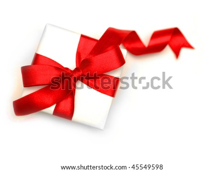 White gift pack tied up by a red tape - stock photo