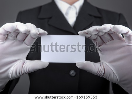 White-gloved hands holding a plastic card - stock photo