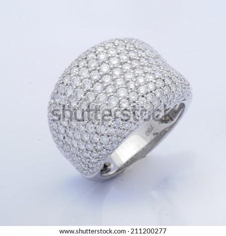 White gold ring with white diamonds,Wedding Ring with diamond. Jewelry background - stock photo