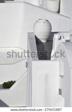 white greek amfora in a street of Santorini island, Greece - stock photo