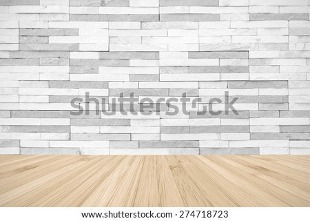 White grey colour brick tile textured wall with wood floor in light yellow cream color tone: Stone tile wall with wooden floor for interior backgrounds - stock photo