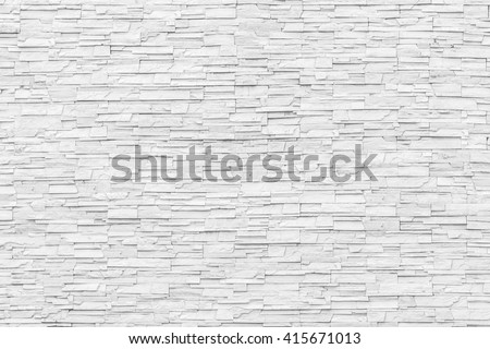 White grey gray rock stone brick tile wall aged texture detailed pattern background: Grunge ancient rustic limestone rural stonework block masonry patterned backdrop for architectural decoration - stock photo