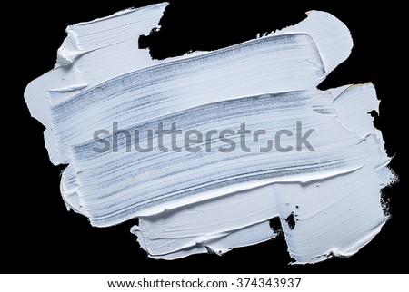 white grunge brush strokes paint on black background - stock photo