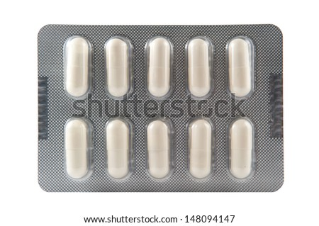 White hard capsule in transparent blister pack  - stock photo