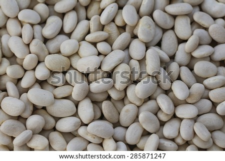 White haricot beans background. Haricot bean texture close up. - stock photo