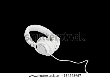 White headphones on black background - stock photo