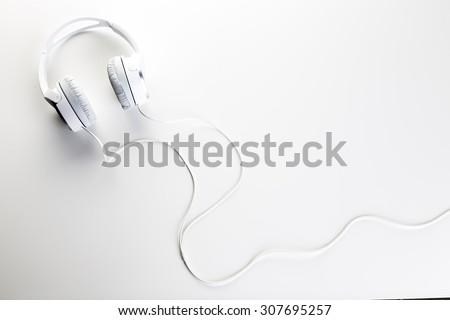White headphones on white background - stock photo