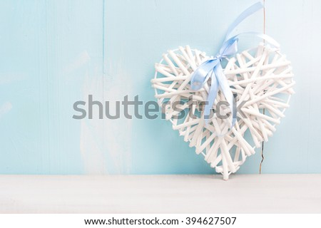 White heart on blue wooden background empty space.Valentine's holiday concept.Love symbol.Wedding romantic card. - stock photo