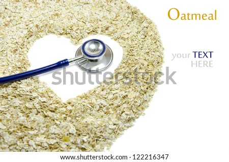 White heart painted on oatmeal with Stethoscope. - stock photo