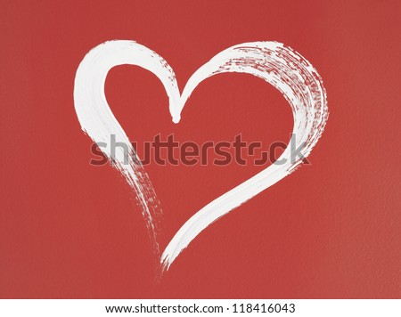 White heart painted on red background. Brush stroke texture. - stock photo