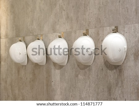 White helmets in a row - stock photo