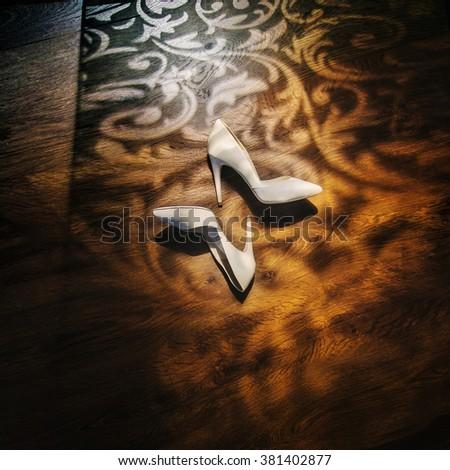 White high heel women shoes on the floor - stock photo