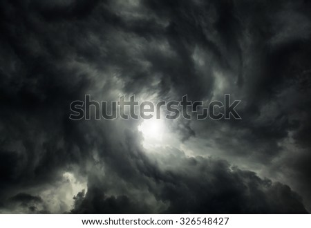 White Hole in the Whirlwind of the Dark Storm Clouds - stock photo