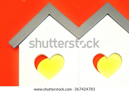 White Home Wooden Shape With Two Yellow Red Heart Shape Window Isolated Background,Love Concept - stock photo