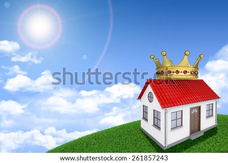 White house on green grassy hill with red roof, crown. Background sun shines brightly. Blue sky - stock photo