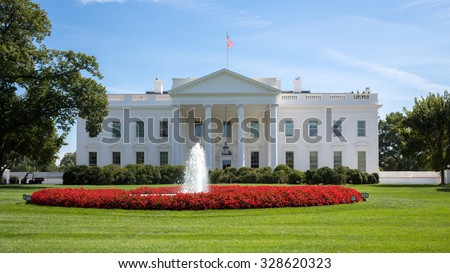 White House with flag, lawn, fountain at summer day. - stock photo