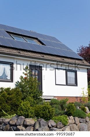 White house with solar panels - stock photo