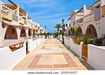 white houses located over a sea - stock photo