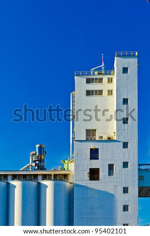 White Industrial Building over blue sky in Vancouver, Canada. - stock photo