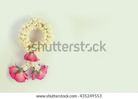 White Jasmine and red rose garland in vintage color with copy space clear background - stock photo