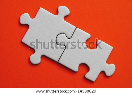 White jigsaw piece on orange  background - stock photo