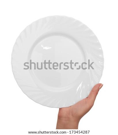 white kitchen plate with hand on white background  - stock photo