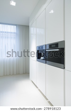 White kitchen units with new built-in oven - stock photo
