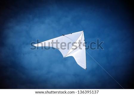 White kite in the sky. - stock photo